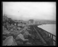 Rocky barricade on a city shoreline.